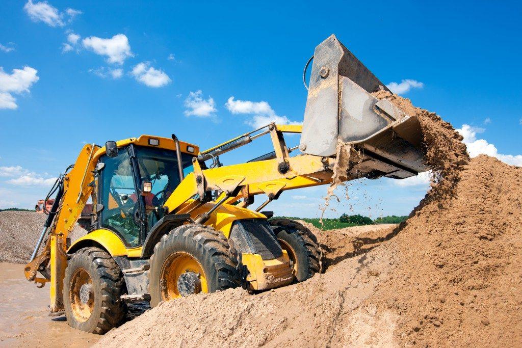 Excavator unloading the soil