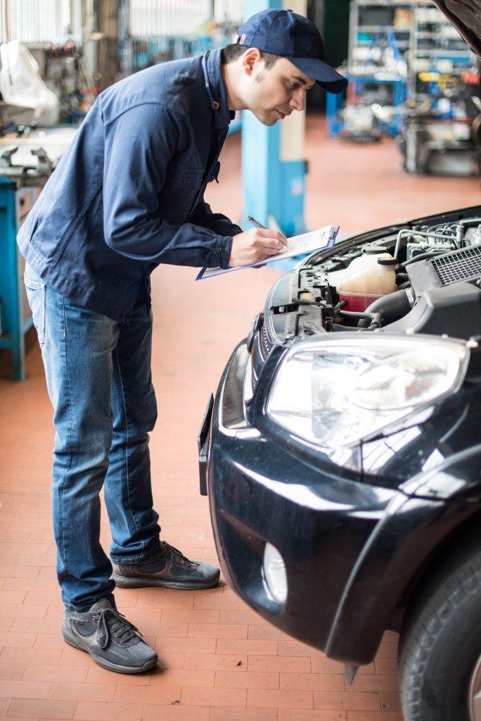 mechanic doing analysis on car engine