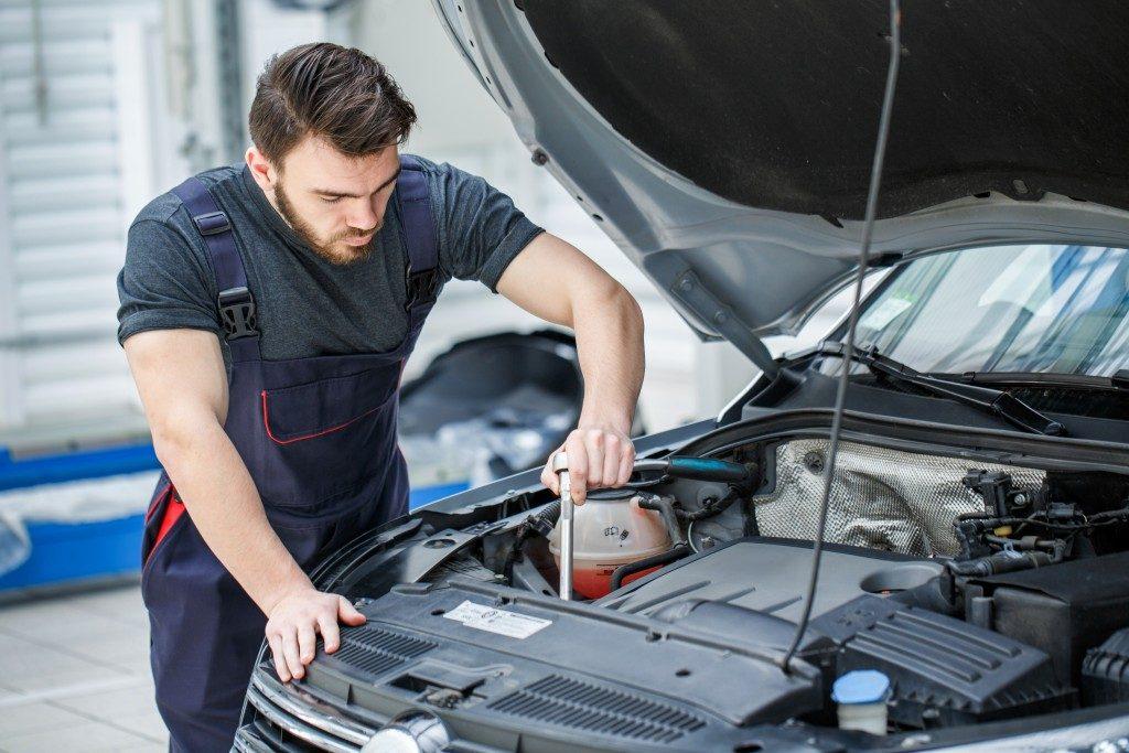 mechanig performing maintenance on engine