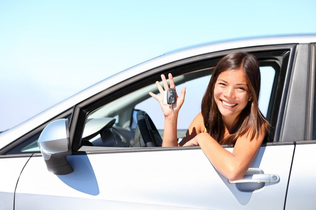 Woman smiling inside the car