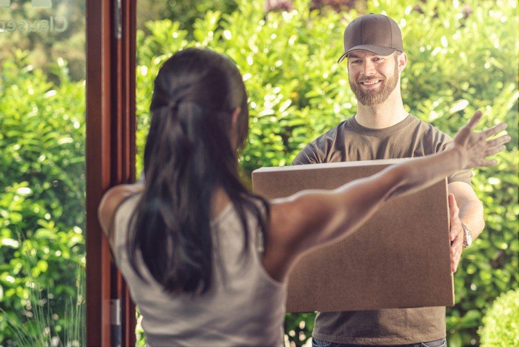 woman receiving a large parcel